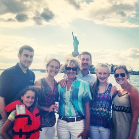 Family photo in front of Statue of Liberty